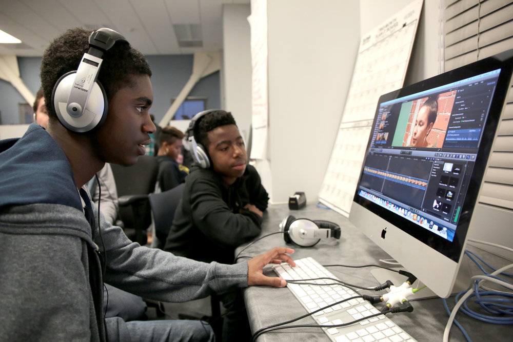 Oakland Tech Senior Charles Sudduth at work editing a video project