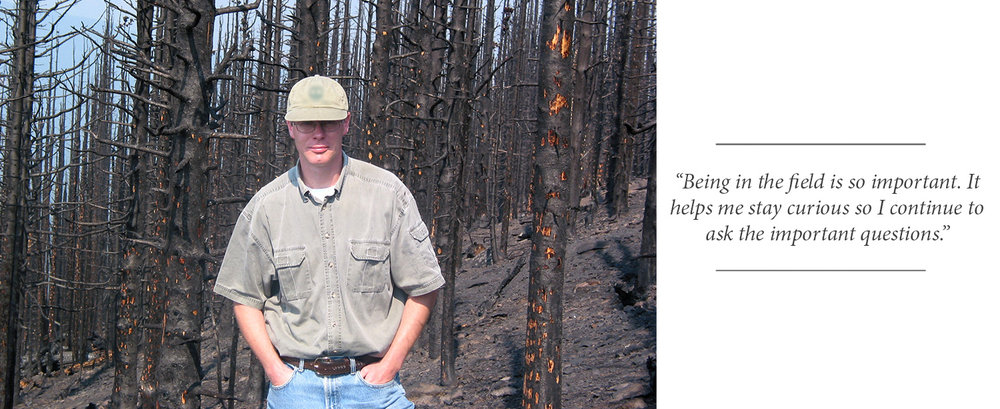 John Stadt, Provincial Forest Ecologist with the Government of Alberta and Science-Policy Advisor for Landscapes in Motion, stands in front of a recently burned forest in Alberta.