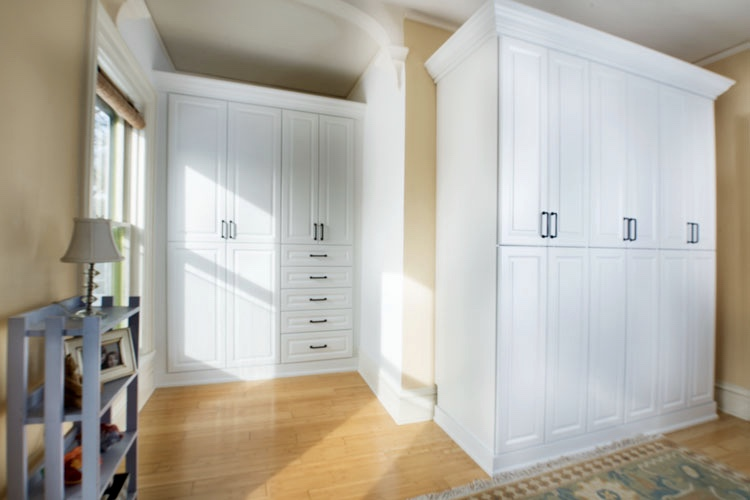 ARCHITECTURALLY INTERESTING STORAGE ADDED TO A ROOM IN THAT OLDER HOME WITH CHARACTER, BUT VERY LITTLE CLOSET SPACE