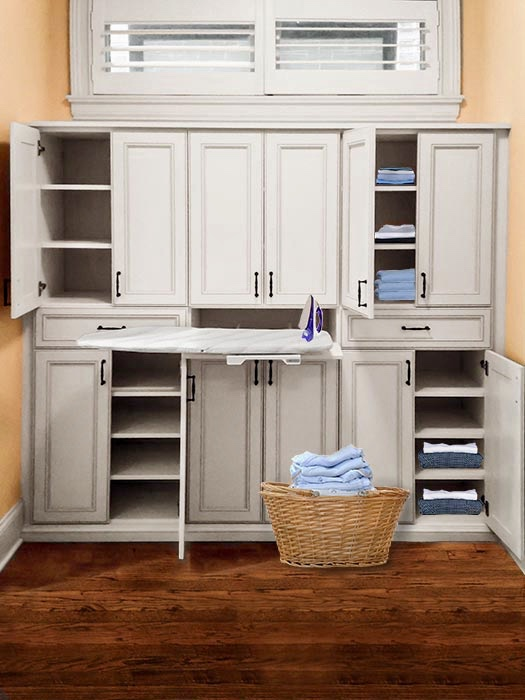 LINEN STORAGE WITH FOLD-OUT IRON BOARD. BUILT-IN CABINET LOOK