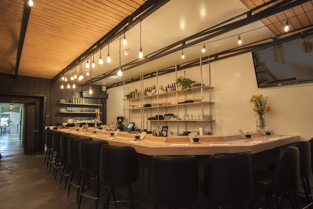 THE BACK AREA   Seats up to 35   The back dining room has a more lounge-y and comfortable feel. A full modern-style sushi bar is available for seating with a flat-screen TV for our guests viewing pleasure. With string Edison bulbs hanging from the top, it gives off a nice lighting effect that goes great with the ambiance of the room. The back dining area is ideal for family gatherings.
