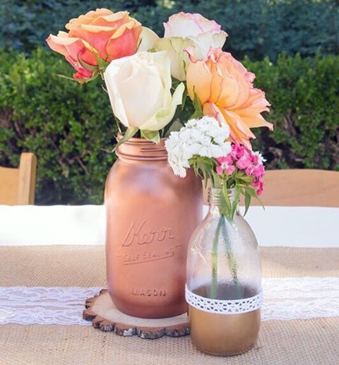 DIY your own center pieces using jars, spray paint and other embellishments. #nunezweddings #floralarrangements #diy #weddingplanning #weddingdiyprojects #floralideas (at Los Angeles County)