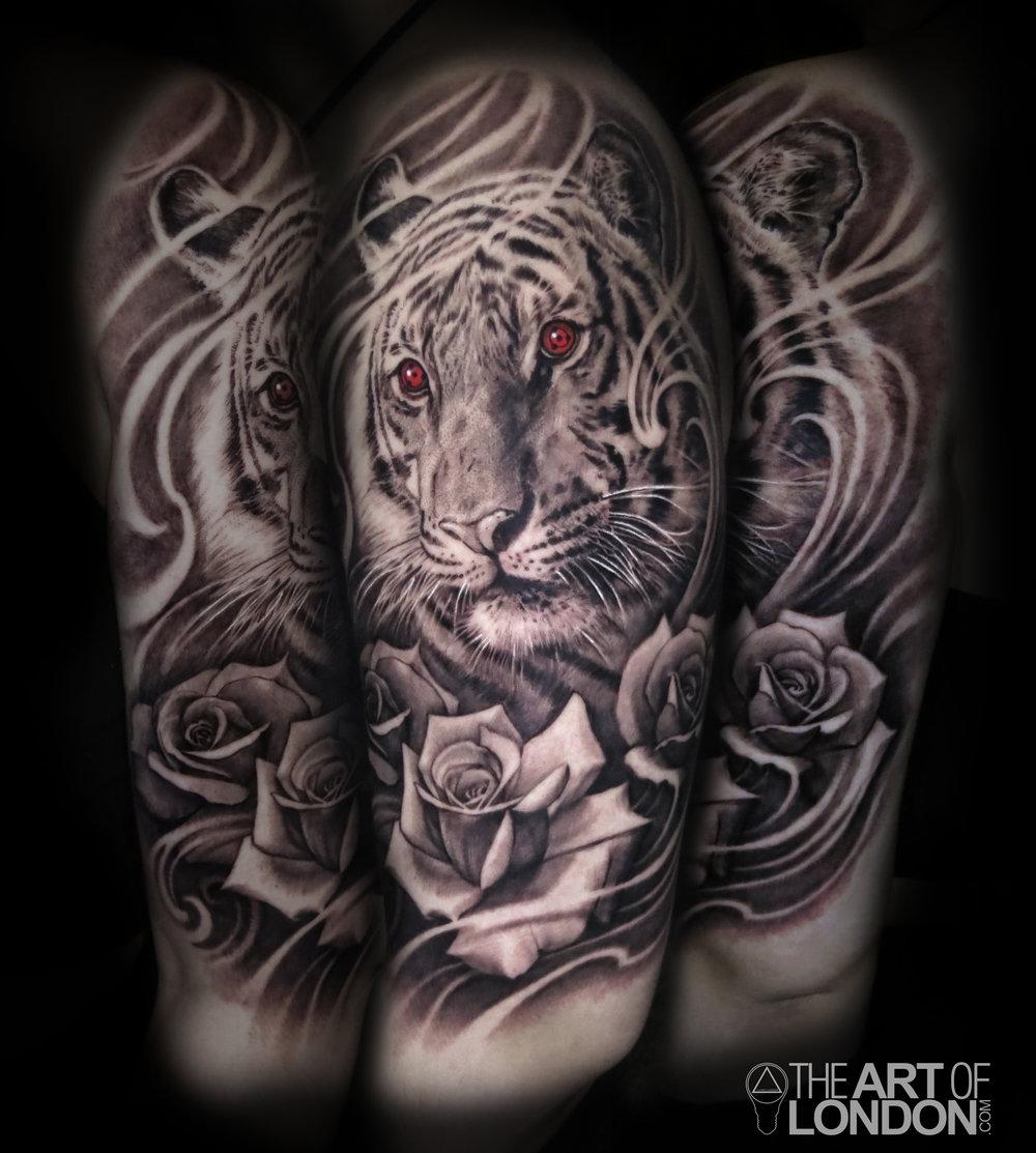 tiger roses naruto black and grey tattoo.jpg