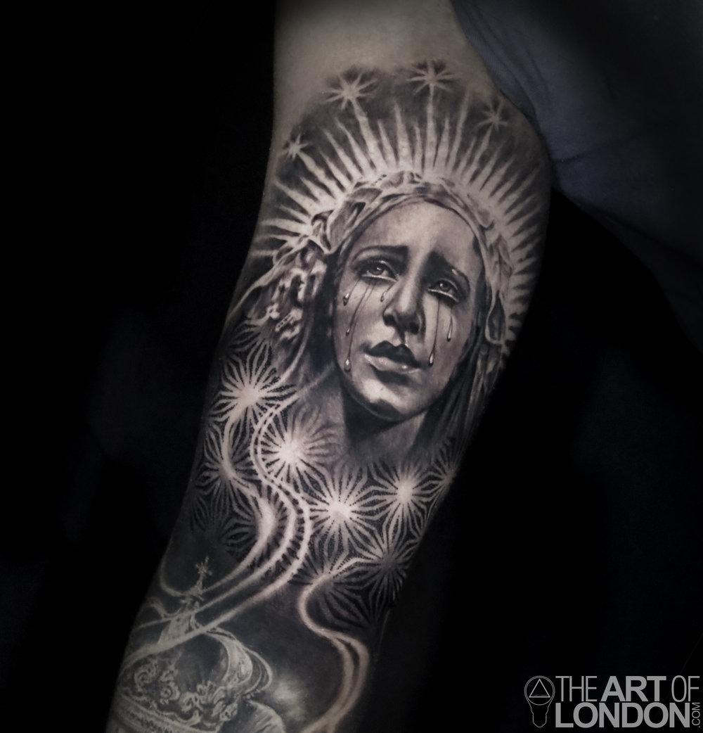 virgin mary guatemalan statue tattoo.jpg