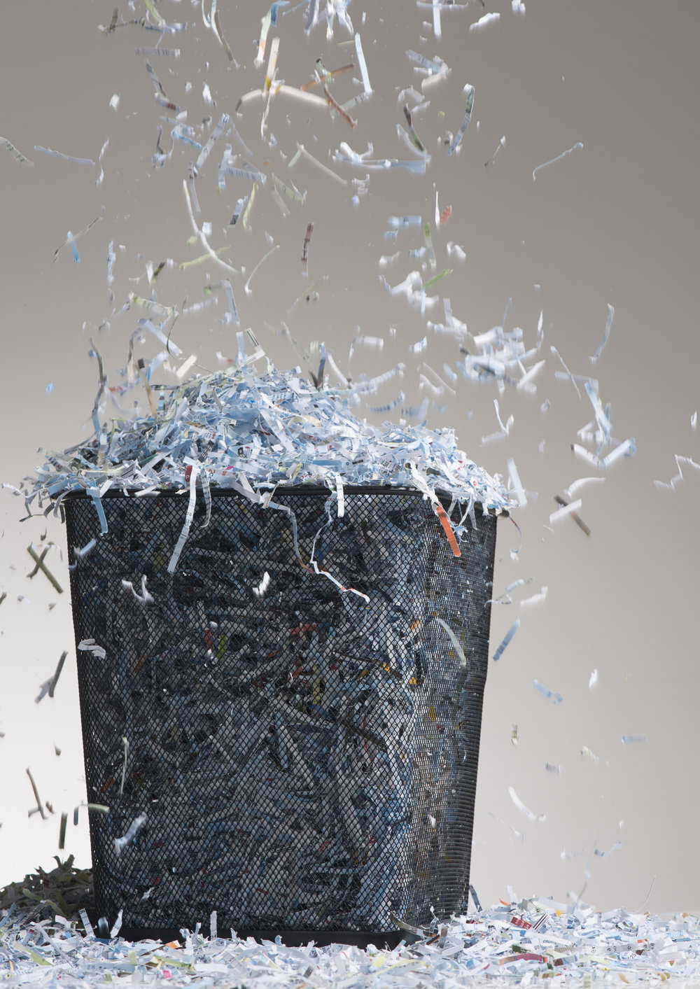 SHREDDING SERVICES - Now that you've met your retention obligations,what are you supposed to do with hundreds, or even thousands, of pounds of paper documents full of sensitive personal, corporate, or government information? Just call or send us an email! If we're already storing the documents, our bar-code technology eliminates accidental disposal and makes it easy for us to identify and destroy only the items you tell us to. On a more personal note, if you have a box of old documents next to your shredder, but you just don't have the time; call us and we'll bring you a secure bin that can be filled and retrieved for destruction at your convenience.