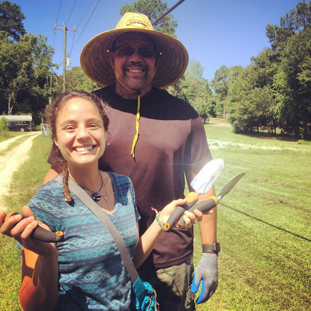 Father and daughter gardening at Ricks Place.JPG