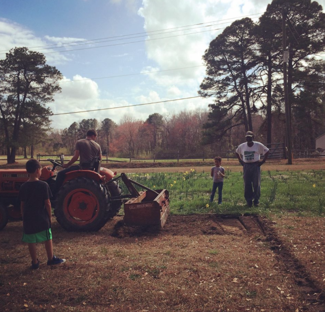 Gunner, Karl and kids start up the 2018 garden season at Rick's Place.