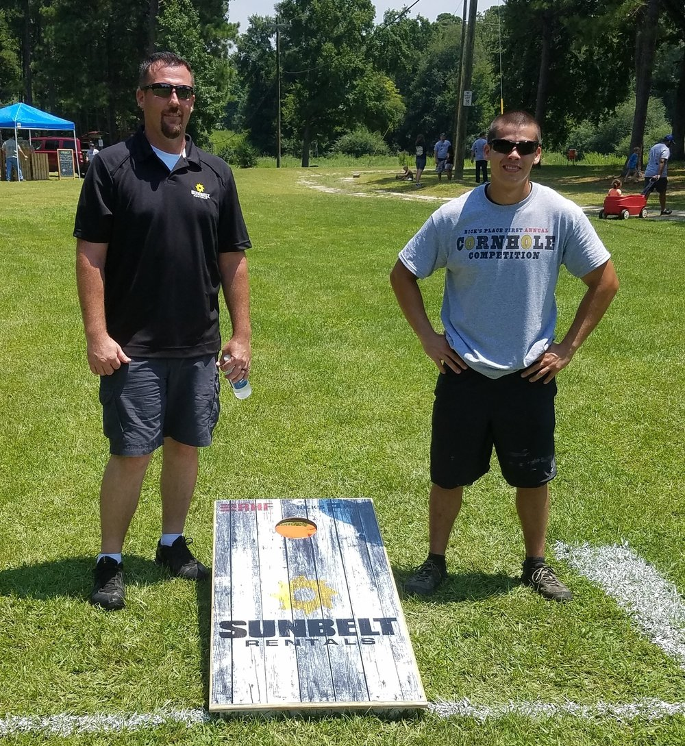 Chris with Sunbelt Rentals and Jay, a Rick's Place volunteer, were our Cornhole Champions
