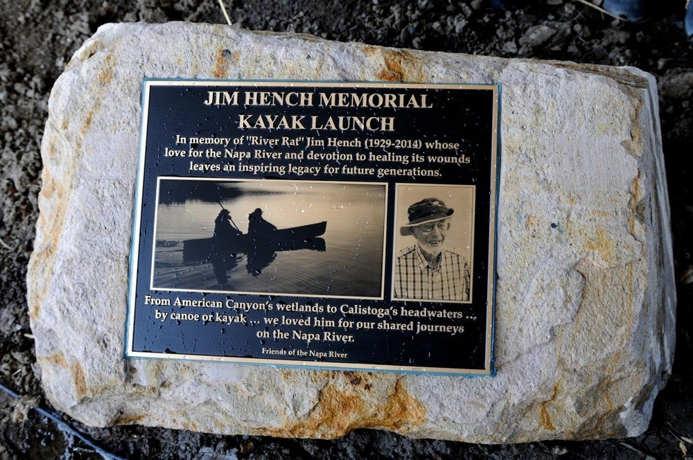 The plaque commemorating the Jim Hench Memorial Kayak Launch: freshly blessed with water from the Napa River. Photo by Lowell Downey