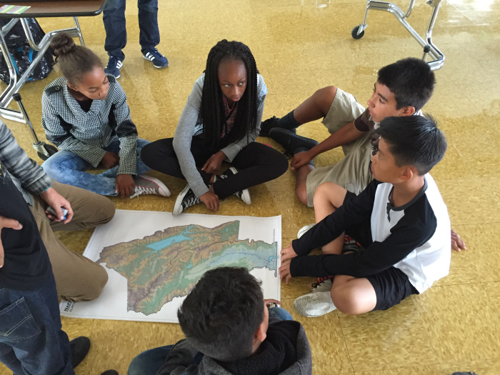 Paddlers learn how to teach their younger peers about the tidal Napa River and its watershed