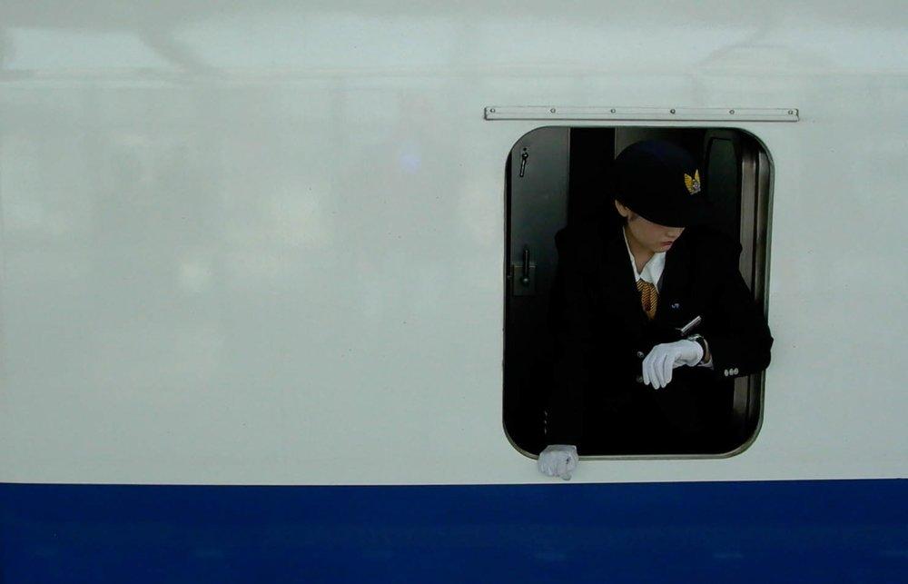 The Crisply Pressed Uniform Of A Shinkansen Conductor