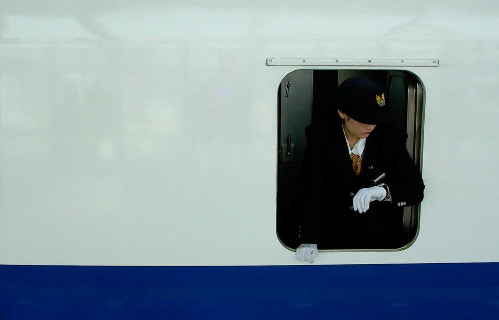 The Crisply-Pressed Uniform of a Shinkansen Conductor