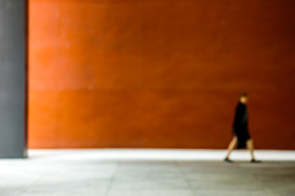 Figures Against an Orange Wall/3