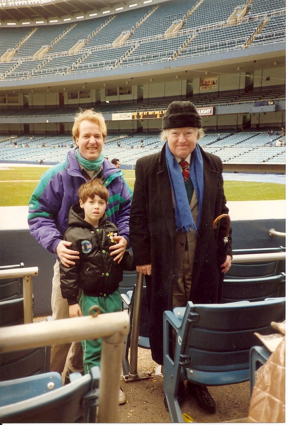A young Douglas with his father and son at Yankee Stadium