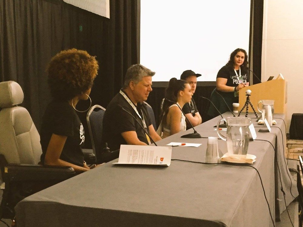 [Image: Disabilities on YouTube Panel from VidCon US 2016; Alexandria is on the far right moderating the panel, then [right to left], James Rath, Molly Burke, Tommy Edison, and Lolo (SittingPretty]