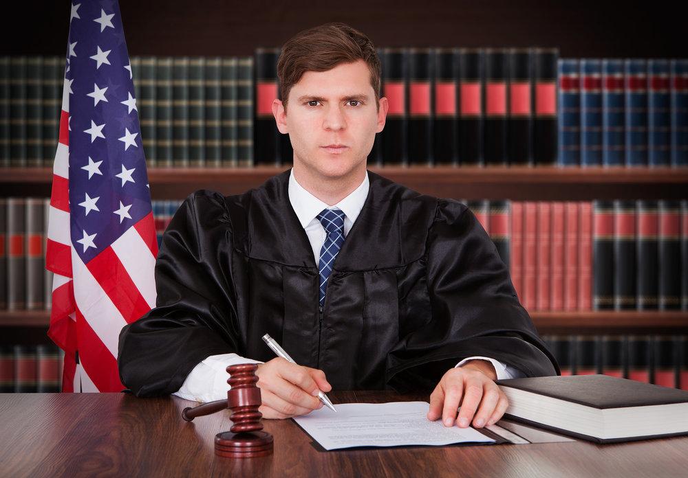 bigstock-Male-Judge-In-Courtroom-83729756.jpg