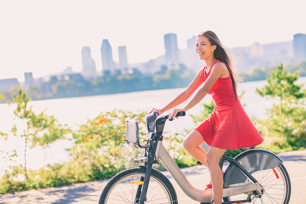 bigstock-City-bike-young-woman-biking-r-229851064.jpg