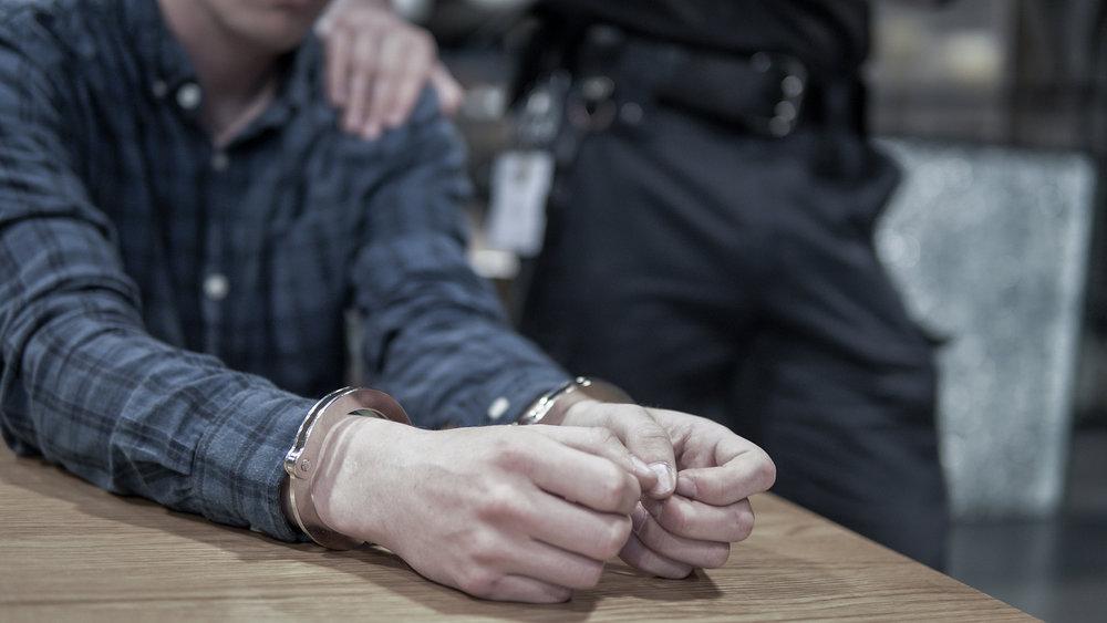 bigstock-Criminal-Arrested-And-Handcuff-239871538 (1).jpg