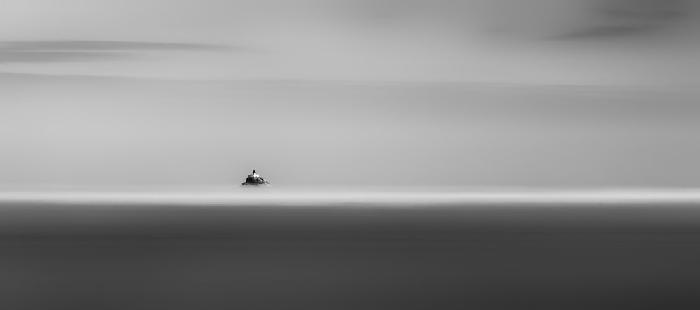 Lighthouse Out To Sea BW.jpg