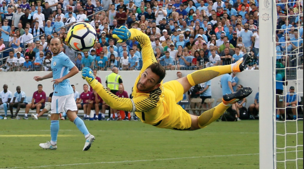 Manchester City's Hugo Lloris makes diving save