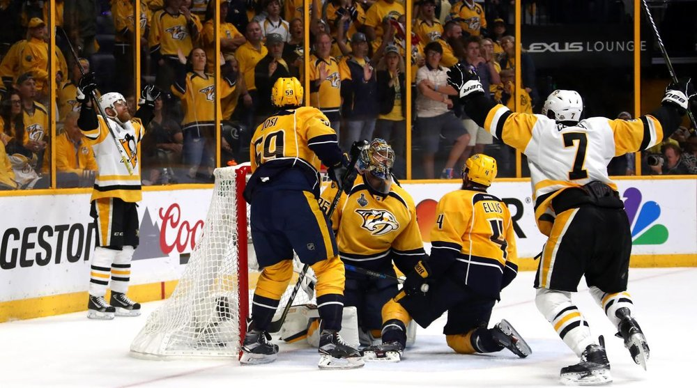 Patric Hornqvist raises his hand to the sky after he scored the Stanley Cup winning goal.Source- Sports Illistrated