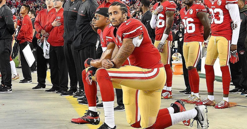 Colin Kaepernick takes a knee during the National Anthem. Starting the recent protest