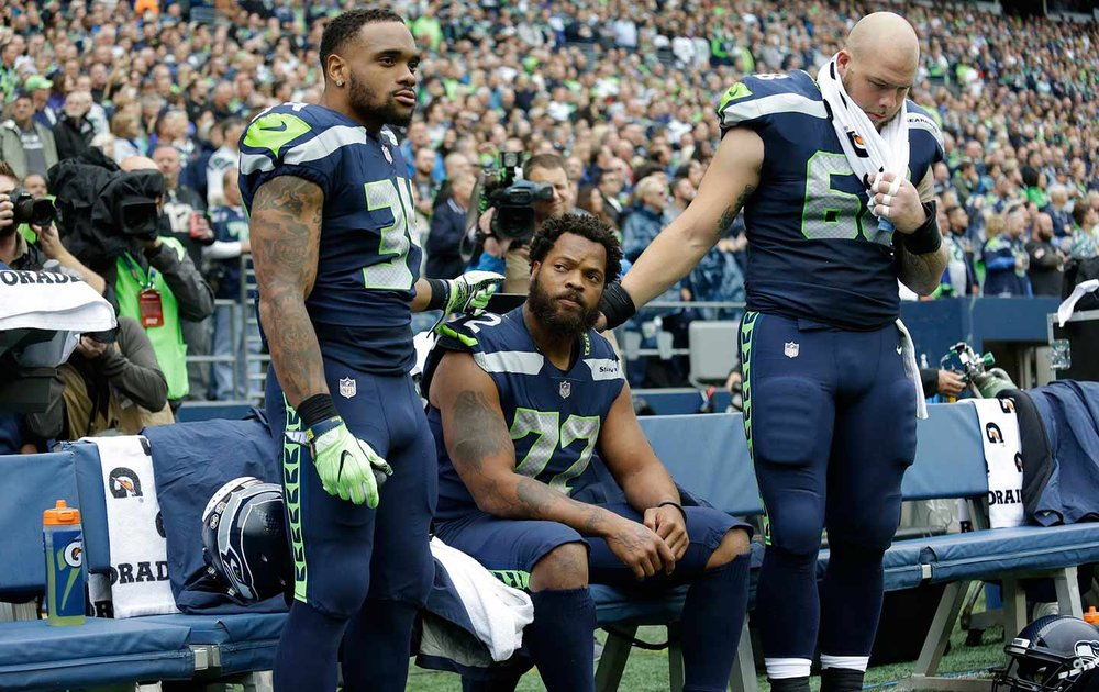 Michael Bennett sit during the Anthem.