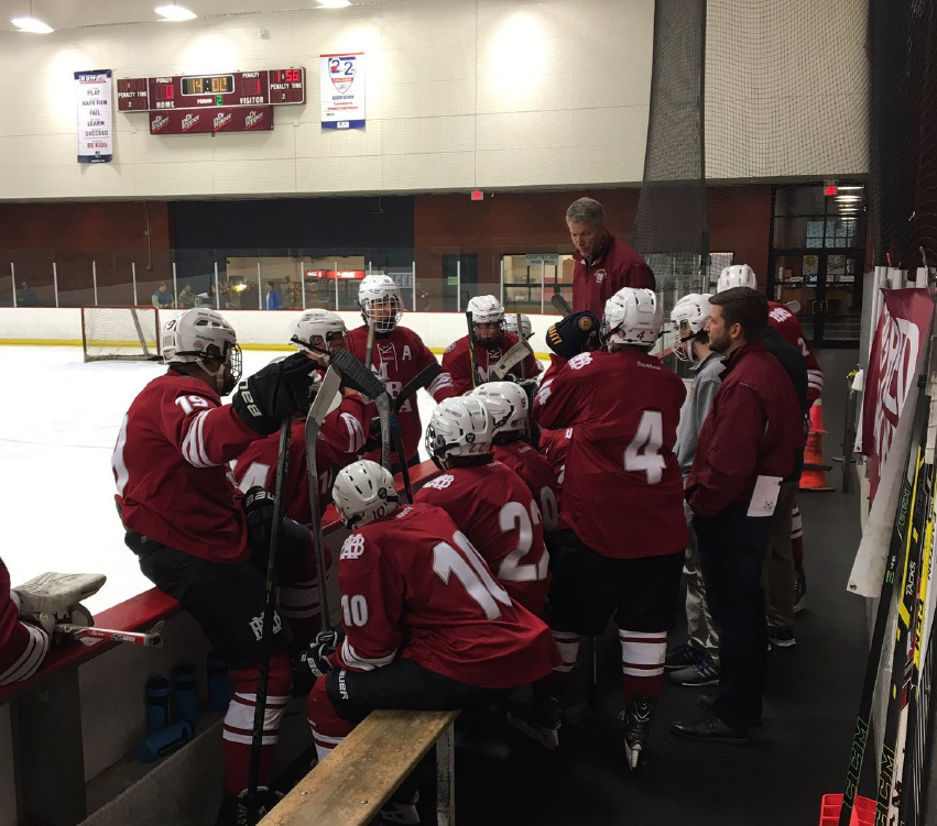 TEAM TALK: Coach Tim Kovick tries to instill some knowledge in his team.