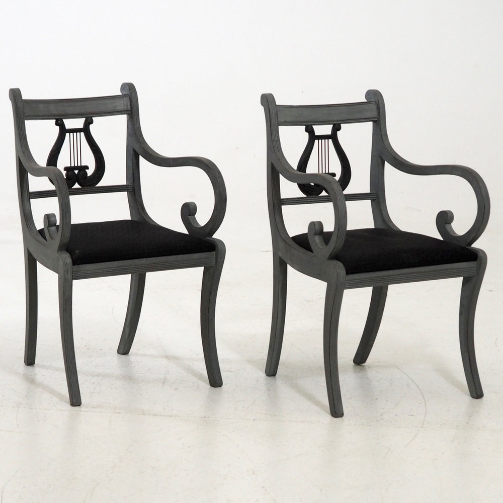 Pair of lyre-back chairs. - € 600