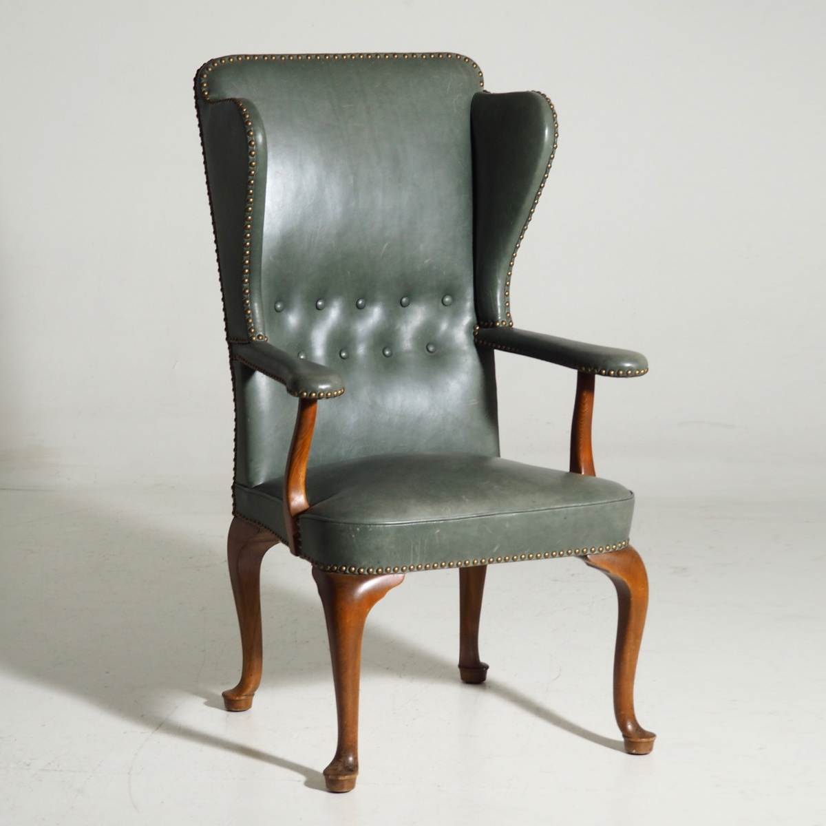 13177 2a Rare Wingback Chair Attributed To Frits Henningsen Upholstered With Green Leather And Brass Nails Selected Design Antiques
