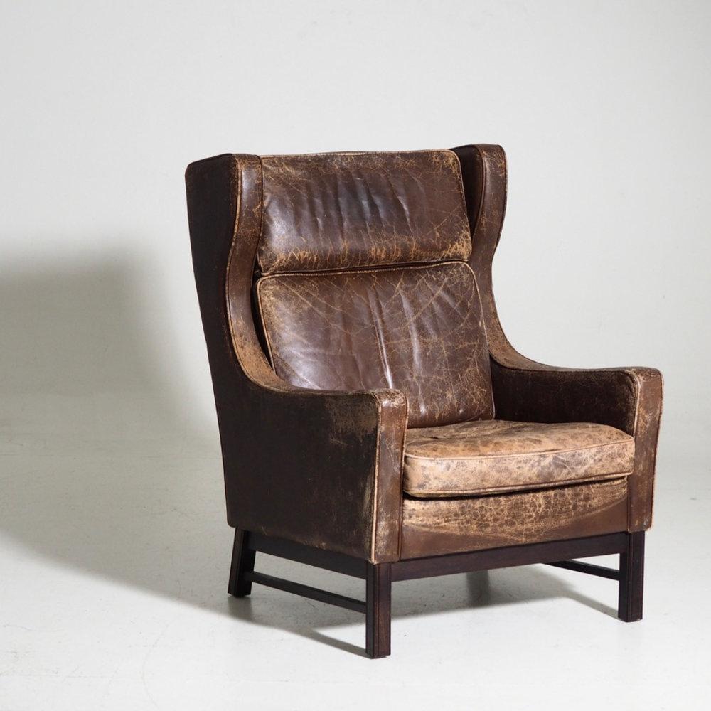 Wingback armchair, 60's. - € 400