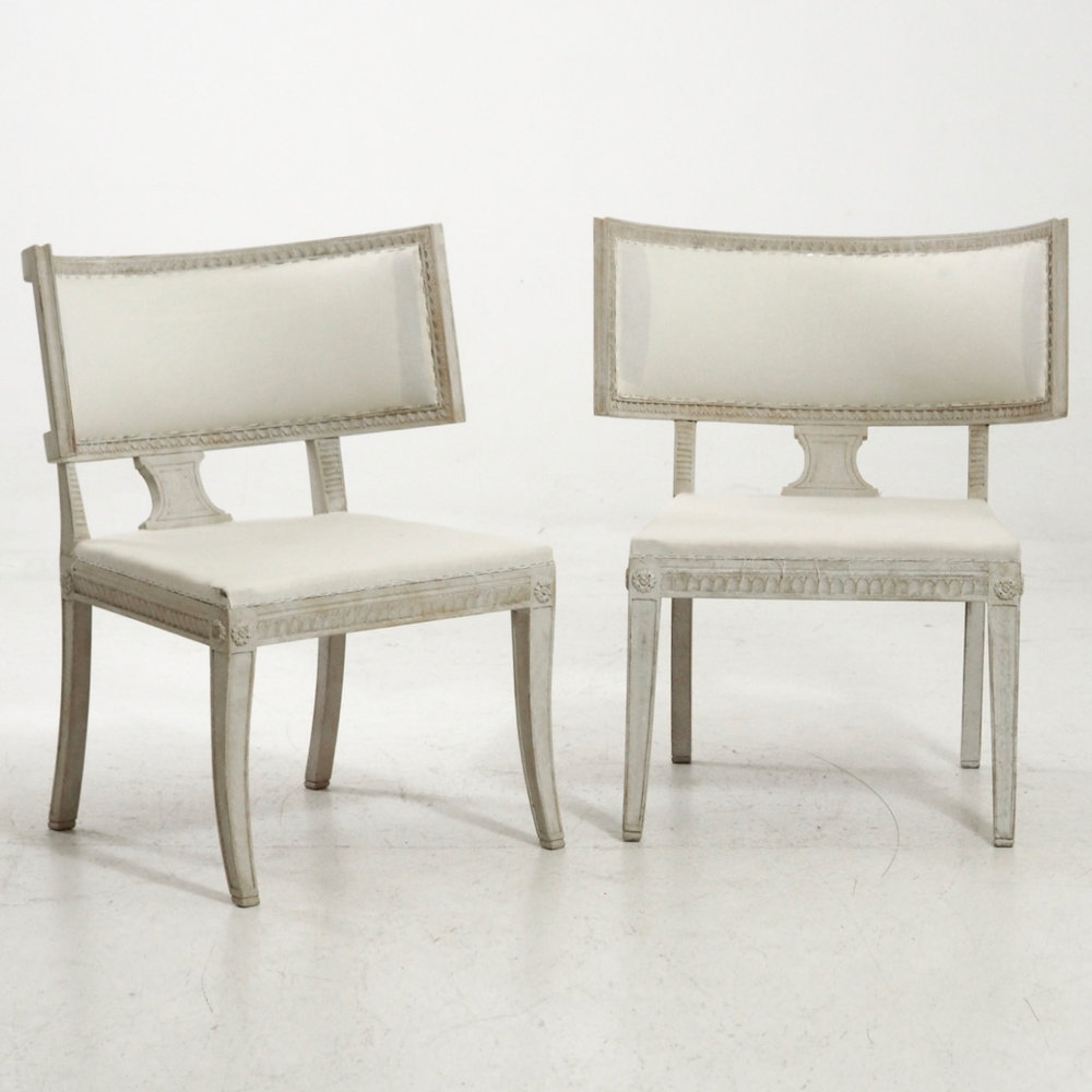 Pair of large chairs with sabel legs. - € 2.600