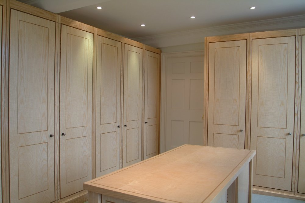 A DRESSING ROOM WHICH IS PART OF A RANGE OF OUR WORK IN ONE COTSWOLD HOUSE