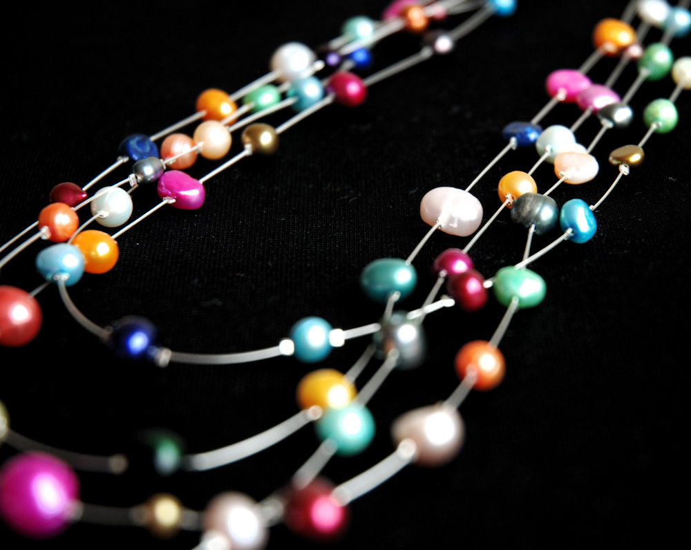 Multicoloured pearl four strand necklace
