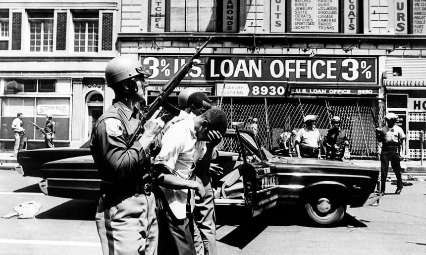 Policemen arrest black suspects in a Detroit street during riots that erupted in Detroit following a police operation in 1967. Photograph: AFP/Getty Images