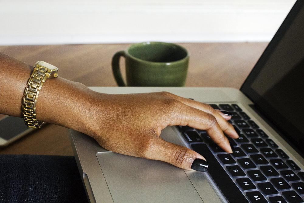 black-woman-hand-on-laptop-createherstock.jpg