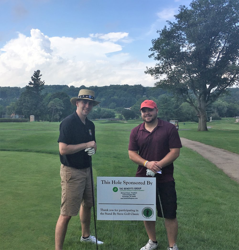 Kieran Cleary (L) and Gerry Cleary (R) take part in an annual golf outing held for a beloved member of the community.