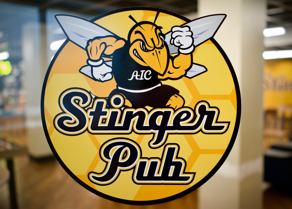 WELCOME TO THE STINGER PUB - Located in the lower level of AIC's Dining Commons, the newly renovated Stinger Pub is the campus' premier bar and restaurant venue.We offer a wide variety of domestic and imported beers, wines, and nonalcoholic beverages, as well as a selection of pub favorites.