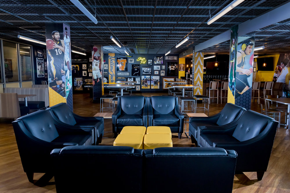 Leather Couches with AIC memorabilia mounted on walls and columns