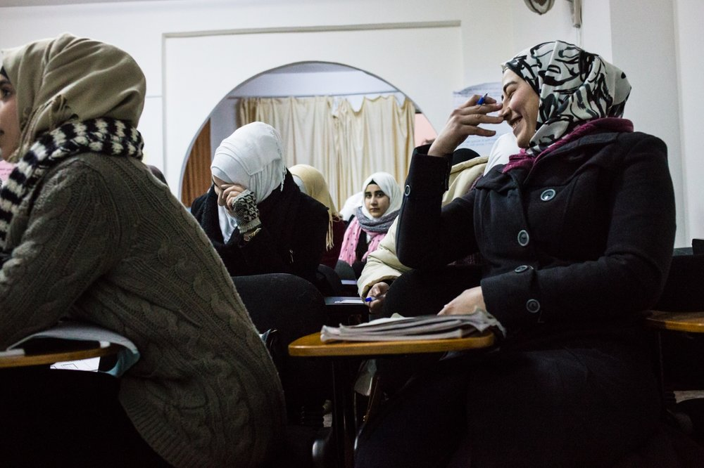 Young Syrian women attend courses taught by volunteers at the Souriat Beyond Borders center in Amman. Since many of them were forced to miss school for some time due to the war, the classes help them get caught up so they can take university entrance exams.