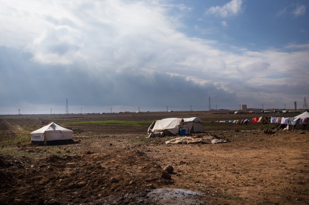 An informal tented settlement (ITS), home to about 20 Syrian refugees, sits on agricultural land close to the Syrian border.