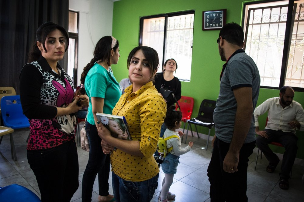 Iraqi Christian women talk together after an English class at Collateral Repair Project's community center. Many of the families who come to the center are awaiting resettlement in other countries, and want to learn English to prepare for their new life, or in hopes of finding better job opportunities in Jordan.