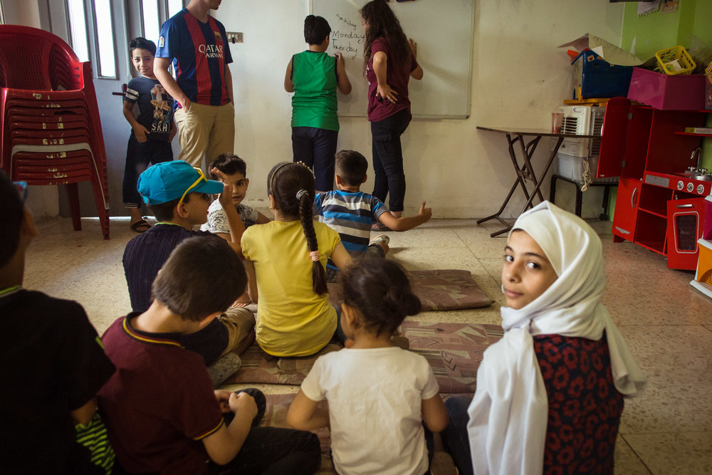 Iraqi and Syrian children attend a summer camp program at Collateral Repair Project's community center in Amman, Jordan.