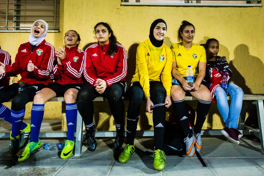 Rand Al-Bustanji (3rd right) sits on the sidelines with her teammates during practice. Rand is the goalkeeper for Jordan's women's under-17 team and competed in the FIFA world cup held in Jordan in 2016.