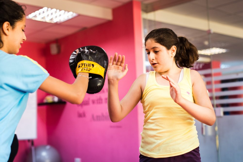 Reem Habib and Sana Kayyali practice different punching and kicking techniques in a self defense course at She Fighter in Amman, Jordan, on August 21, 2015. The She Fighter studio was founded by Lina Khalifeh, and offers self defense classes to young women to protect against harassment.