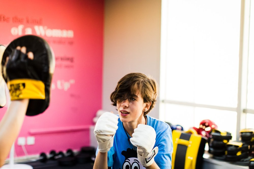 Nour Abu Rahma and Selina Hajarat practice different striking techniques during a self defense class at She Fighter in Amman, Jordan, on August 21, 2015. The She Fighter studio was founded by Lina Khalifeh, and offers self defense classes to young women to protect against harassment.