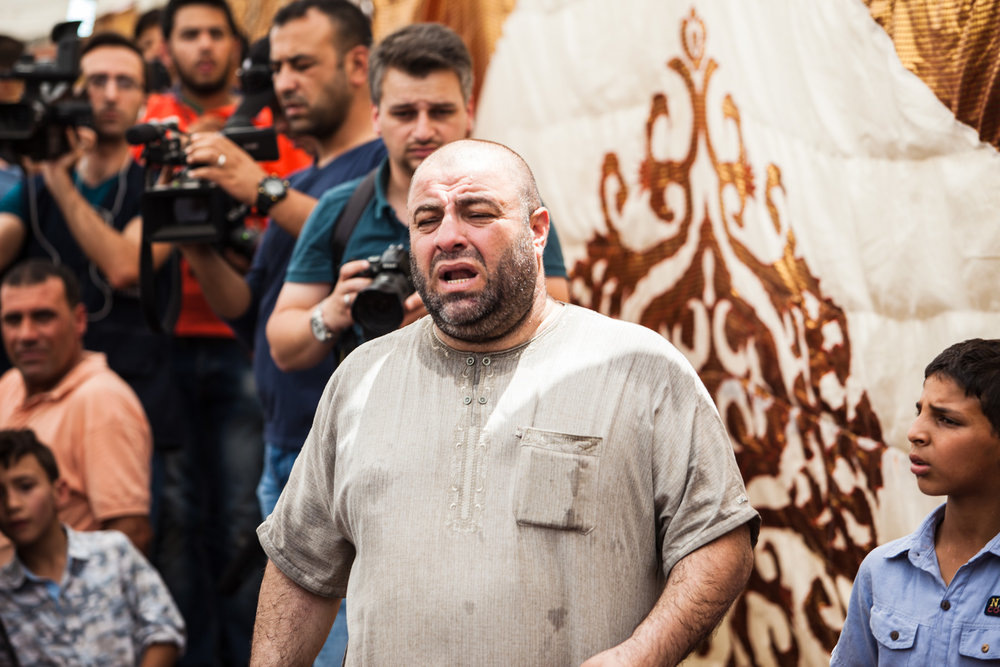 Zakaria al-Jawawdeh, father of Mohammed al-Jawawdeh, a 16-year-old Jordanian, who was killed on Sunday evening by an Israeli security guard who said he was attacked by him with a screwsdriver, cries out with emotion at his son's funeral on Tuesday, July 25, 2017 in Amman, Jordan.