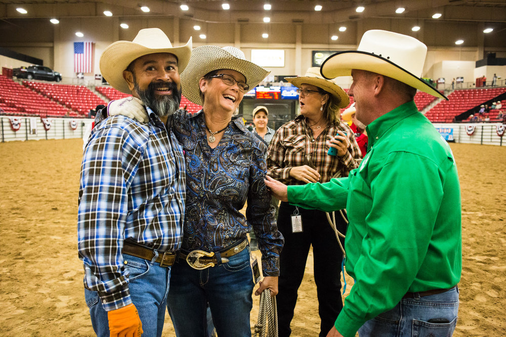 Deb Freeman of Morgan Hill, CA, is congratulated by friends after successfully roping her calf during the World Gay Rodeo Finals in Las Vegas, NV.