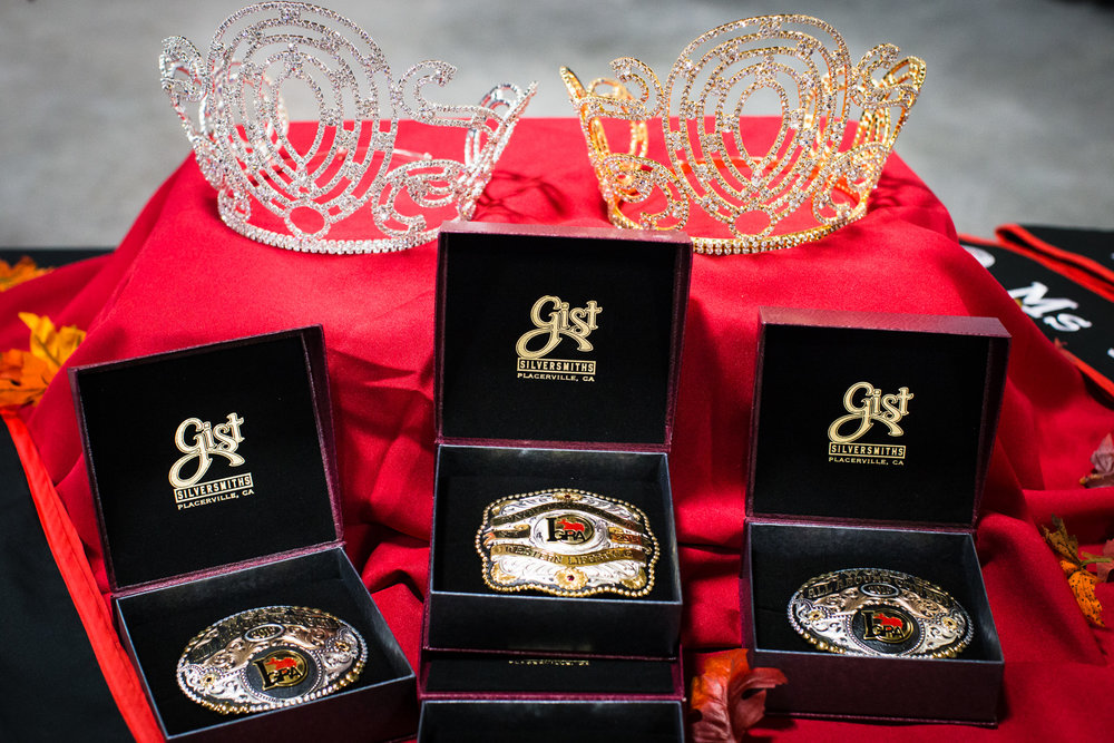 Crowns, sashes, and custom belt buckles are some of the awards doled out to the winners of the International Gay Rodeo Association's Royalty Contest. The titles of Mr., Ms., Miss, and MsTer are awarded after contestants successfully complete the interview, western wear, horsemanship, public presentation, and entertainment. The contest helps generate revenue for the IGRA.