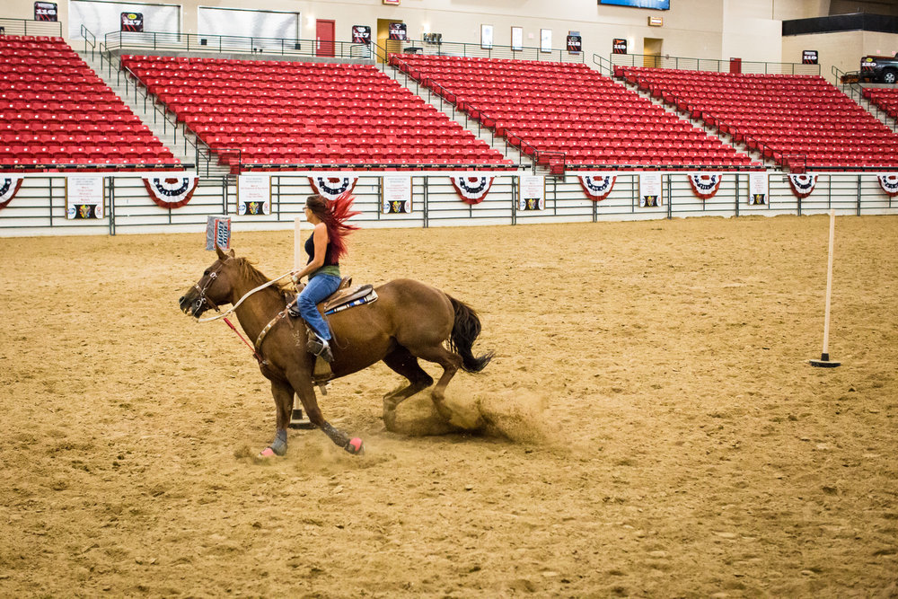 Britany Davis, of Boulder City, NV, takes her horse Kid on a practice run of pole bending at the World Gay Rodeo Finals in Las Vegas, NV.